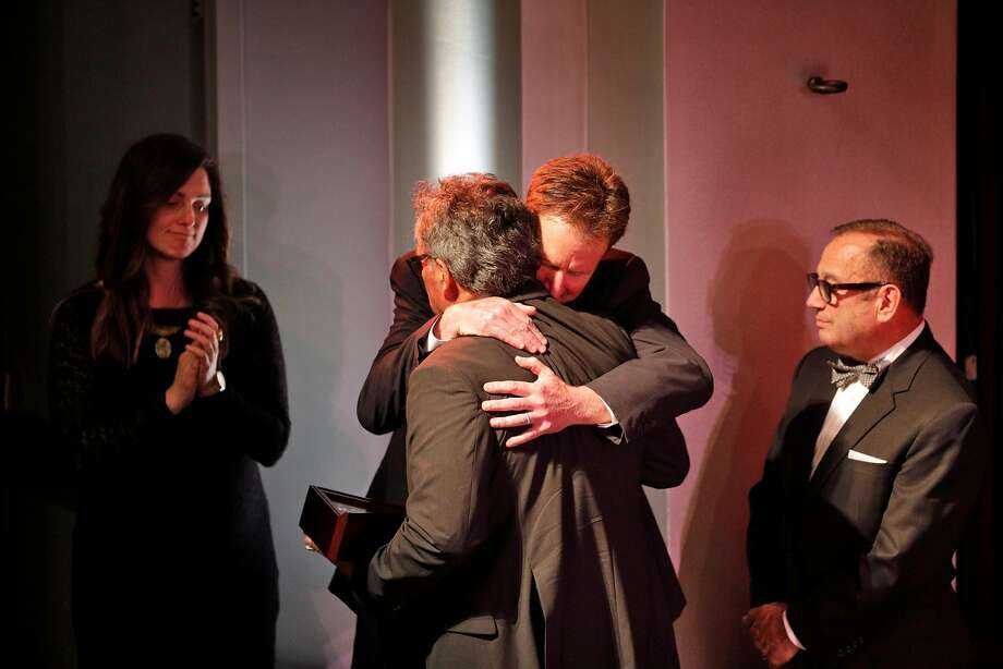 Mike Gonzales, father of Jennifer Gonzales Shushereba gets a hug from Keith Armstrong, as Brandina Jersky, left, and Dr. Vito Imbasciani watch after Gonzales spoke to the audience about his daughter during a memorial service for Christine Loeber, Dr. Jennifer Gray Golick, and Jennifer Gonzales Shushereba, on Monday, March 19, 2018 in Yountville, Calif., on Monday, March 19, 2018. Photo: Carlos Avila Gonzalez, The Chronicle