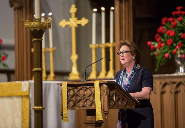 Kim Ogg reads from the Book of Isaiah during a memorial service for her father, former Texas State Senator Jack C. Ogg, at St. Martin's Episcopal Church, Monday, March 19, 2018, in Houston.