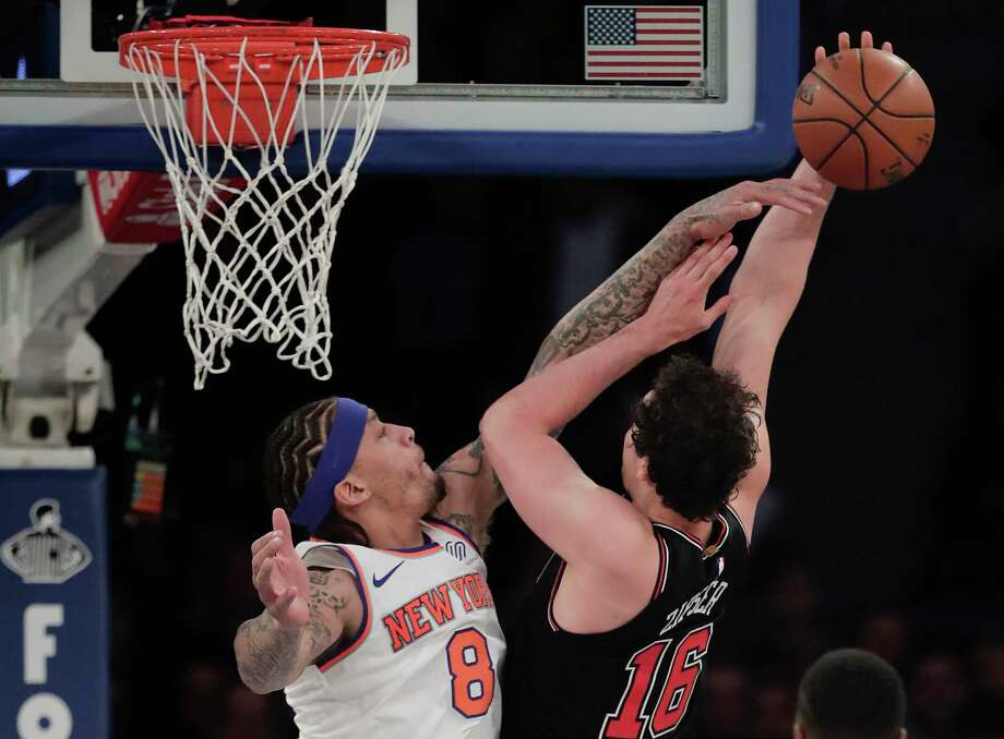 Chicago Bulls forward Paul Zipser (16) shoots against New York Knicks forward Michael Beasley (8) during the first quarter of an NBA basketball game, Monday, March 19, 2018, in New York. (AP Photo/Julie Jacobson) Photo: Julie Jacobson / Copyright 2018 The Associated Press. All rights reserved.