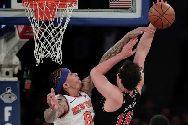 Chicago Bulls forward Paul Zipser (16) shoots against New York Knicks forward Michael Beasley (8) during the first quarter of an NBA basketball game, Monday, March 19, 2018, in New York. (AP Photo/Julie Jacobson)