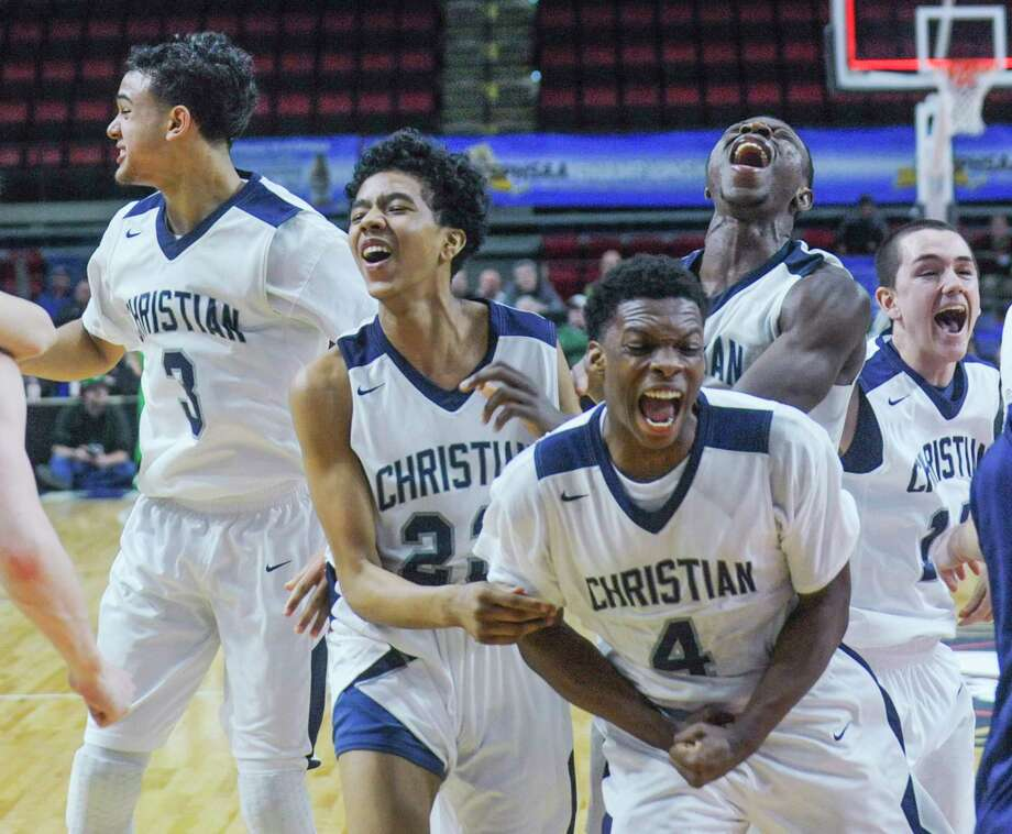 Mekeel Christian Academy players celebrate their 42-37 win over Seton in the NYSPHSAA Class B Boys Basketball championship game on Saturday, March 17, 2018, at Floyd L. Maines Arena in Binghamton, N.Y.  (Tim Roske/Special to the Times Union) Photo: TIm Roske / 20043218A