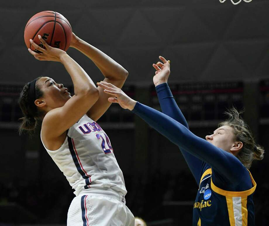 Connecticut's Napheesa Collier, left, shoots over Quinnipiac's Paula Strautmane during the first half of a second-round game in the NCAA women's college basketball tournament in in Storrs, Conn., Monday, March 19, 2018. (AP Photo/Jessica Hill) Photo: Jessica Hill / AP2018