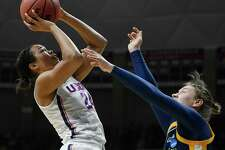 Connecticut's Napheesa Collier, left, shoots over Quinnipiac's Paula Strautmane during the first half of a second-round game in the NCAA women's college basketball tournament in in Storrs, Conn., Monday, March 19, 2018. (AP Photo/Jessica Hill)