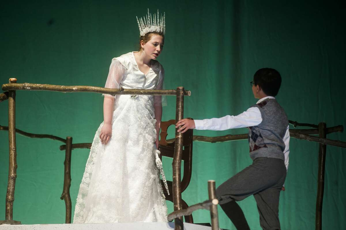 Gretchen Shope, as the White Witch, left, and Owen DeLong, as Edmund, right, act out a scene during a dress rehearsal for Peanut Gallery's production of