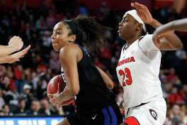 Duke guard Lexie Brown, left, drives the ball passed Georgia guard Que Morrison (23) during the second half of a second-round game in the NCAA women's college basketball tournament in Athens, Ga., Monday, March 19, 2018. Duke won 66-40. (AP Photo/Joshua L. Jones)