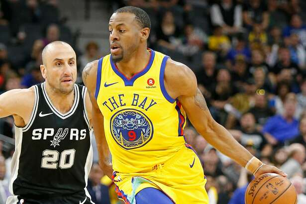 Golden State Warriors' Andre Iguodala drives around San Antonio Spurs' Manu Ginobili during second half action Monday March 19, 2018 at the AT&T Center. The Spurs won 89-75.