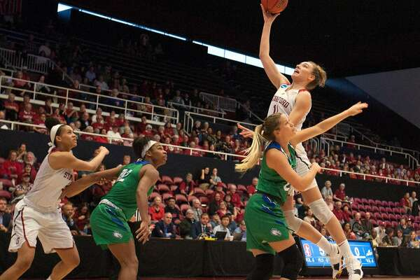 Stanford forward Alanna Smith (11) scores over Florida Gulf Coast guard Taylor Gradinjan (24) during the first half of an NCAA Division I Women's Basketball Championship game, on Monday, March 19, 2018 in Stanford, Calif.