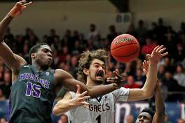 St. Mary's Jordan Hunter vies for a rebound against Washington's Noah Dickerson (15) and Jaylen Nowell in 2nd quarter during NIT 2nd round game in Moraga, Calif., on Monday, March 19, 2018.