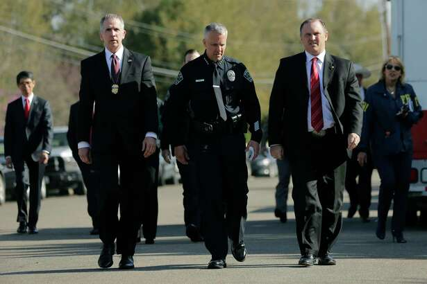"Bureau of Alcohol, Tobacco, Firearms and Explosives Special Agent in Charge Fred Milanowski, front left, Interim Austin police chief Brian Manley, front center, and FBI Special Agent in Charge Christopher Combs, front right, arrive for a news conference near the site of Sunday's explosion, Monday, March 19, 2018, in Austin, Texas. Fear escalated across Austin on Monday after the fourth bombing this month — this time, a blast that was triggered by a tripwire and demonstrated what police said was a ""higher level of sophistication"" than the package bombs used in the previous attacks."