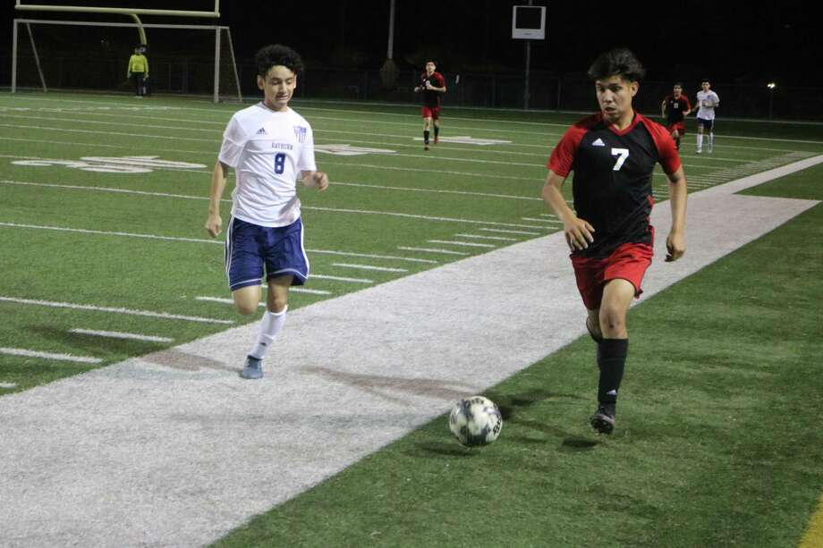 It's a foot race to the Trojans' side of the field Monday night as South Houston attempts to break the match open against their rivals from Sam Rayburn. The Trojans are state playoff bound, following their 6-1 victory. Photo: Robert Avery