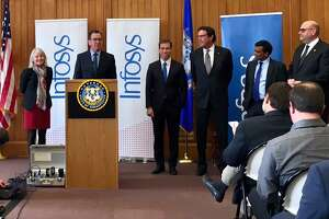 Gov. Dannel P. Malloy announces that Infosys  is planning to establish a technology and innovation hub in Hartford on March 14. Ravi Kumar, the Infosys president, is second from the right.