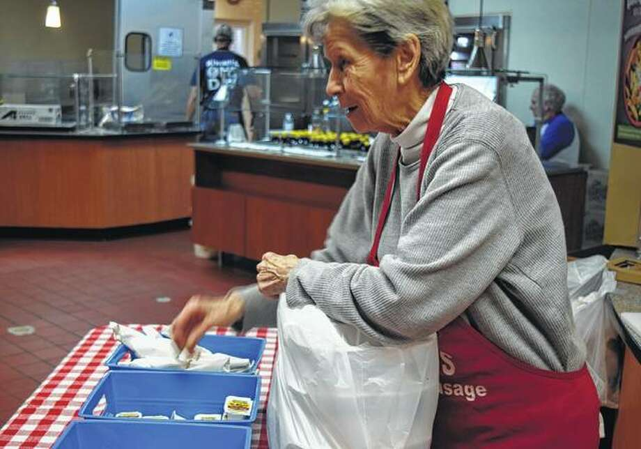 Dorthy Brooks of Jacksonville prepares meals to go Monday during the Kiwanis Pancake and Sausage Day. The annual event is one of the largest Kiwanis fundraisers of the year. Members expected to serve more than 5,000 pancakes. Photo: Samantha McDaniel-Ogletree | Journal-Courier