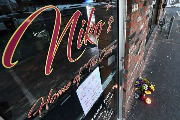 Candles and flowers begin to arrive outside a restaurant named for Niko Dinovo, the 17-year-old from Colonie who died Monday from injuries suffered in an Oct. 28, 2016 car crash.