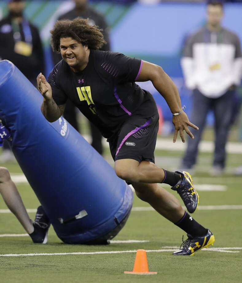 California defensive lineman James Looney runs a drill during the NFL football scouting combine, Sunday, March 4, 2018, in Indianapolis. (AP Photo/Darron Cummings) Photo: Darron Cummings, Associated Press