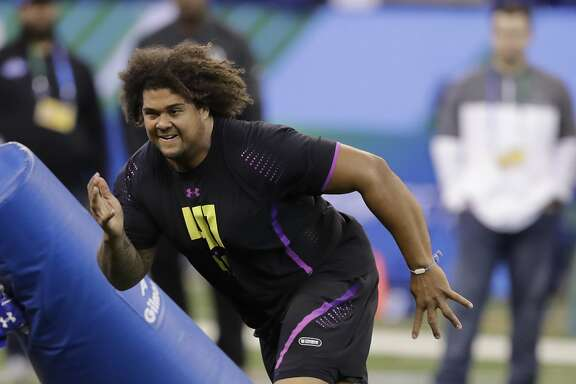 California defensive lineman James Looney runs a drill during the NFL football scouting combine, Sunday, March 4, 2018, in Indianapolis. (AP Photo/Darron Cummings)