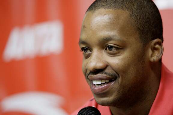 FILE - In this Oct. 17, 2007, file photo, Houston Rockets' Steve Francis smiles during a news conference announcing an endorsement deal with ANTA Sports Products Limited, a company based in China, in Houston. Prosecutors say Francis was arrested Saturday, Nov. 19, 2016, in the Houston-area and is charged with retaliation and DWI. (AP Photo/David J. Phillip, File)