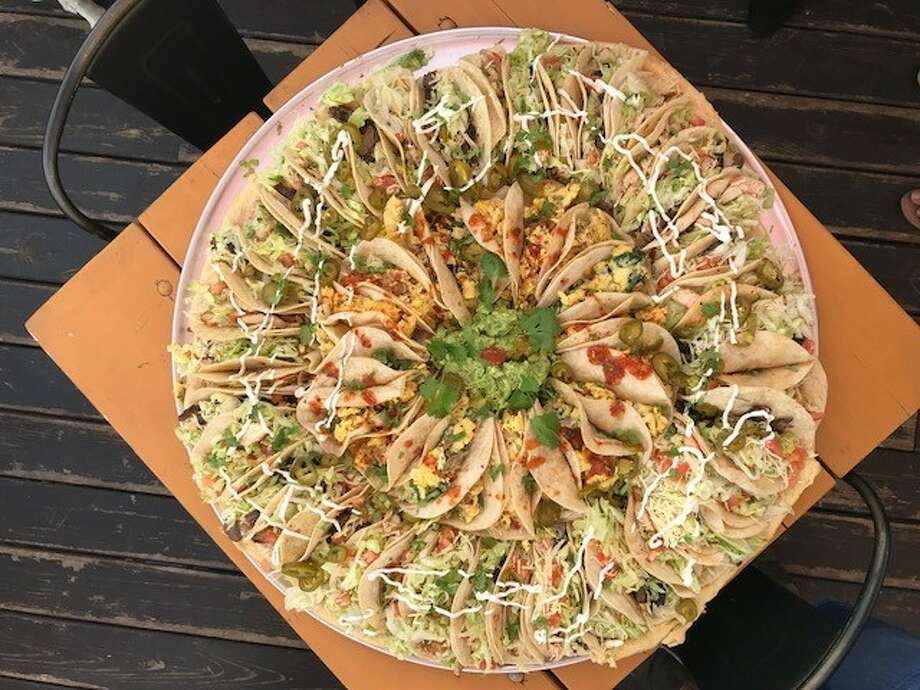 Tacos A Go Go made this 28-inch taco pizza on March 17, 2018 after getting a request about creating it on Twitter. Scroll ahead to see where to find the best tacos in Houston.  Photo: Erika Harrison