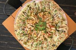 Tacos A Go Go made this 28 inch taco pizza on  March 17, 2018 at the TC Jester location.