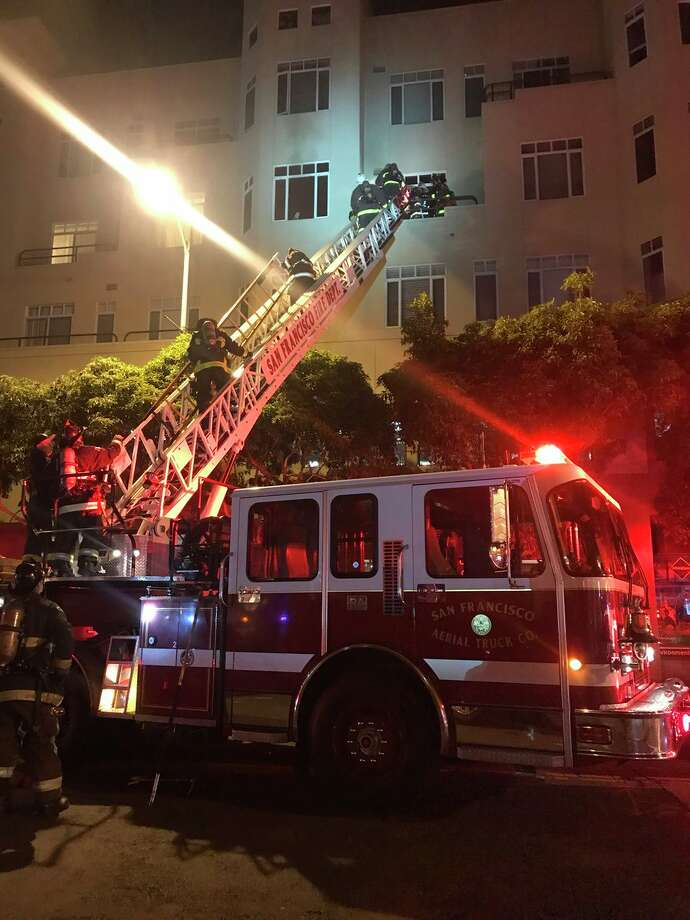 One woman was injured and six were displaced in a Jackson Street fire early Tuesday, March 20, 2018 in San Francisco. Photo: San Francisco Fire Dept.