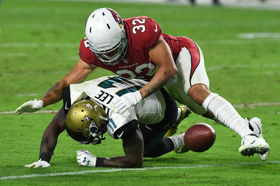 GLENDALE, AZ - NOVEMBER 26:  Marqise Lee #11 of the Jacksonville Jaguars is tackled by Tyrann Mathieu #32 of the Arizona Cardinals in the second half at University of Phoenix Stadium on November 26, 2017 in Glendale, Arizona. The Arizona Cardinals won 27-24.  (Photo by Norm Hall/Getty Images) Photo: Norm Hall/Getty Images