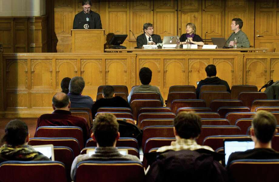 (Melanie Stengel — New Haven Register)    Yale students listen to a panel of experts speak on computer hacking. The panel, left to right: Christopher Soghoian, Matt Blaze, Jennifer Valentino, and Axel Arnbak. The event took place at the Yale Law School.2/18.
