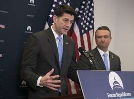 Speaker of the House Paul Ryan, R-Wis., joined by Rep. Don Bacon, R-Neb., right, meets with reporters following a closed-door Republican strategy session on Capitol Hill in Washington, Tuesday, March 20, 2018. Ryan says he's hoping bargainers can resolve the final disputes in a government-wide spending bill in time for Congress to begin voting Thursday on the measure.  (AP Photo/J. Scott Applewhite)