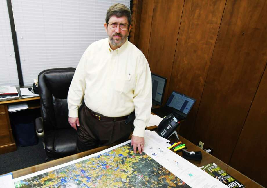 After nearly eight years and approximately 2,000 meetings, George      Shackelford office is nearly all packed up as he divides the remaining      files on his desk and his belongings packed in boxes, signaling the end of      his tenure of as Tomball city manager. The city will host a reception for him from 3 to 4 p.m. March 29 at        Tomball City Hall. Shackelford leaves on April 2. Photo: Tony Gaines /HCN, Photographer