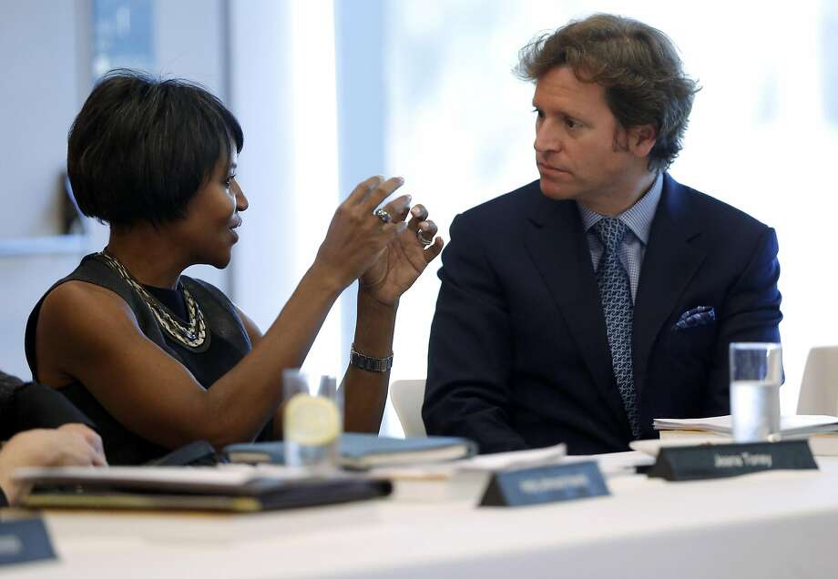 Trevor Traina (right) speaks with another trustee before a Board of Trustees for the Fine Arts Museums of San Francisco meeting at the de Young Museum in San Francisco, California, on Tuesday, Jan. 26, 2016. Photo: Connor Radnovich / The Chronicle