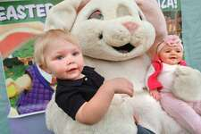 Michael and Emily Patrick get a moment with the Easter Bunny during the annual Easter Egg Hunt Eggs-travaganza at Stew Leonard's in Norwalk on Monday. Kids were greeted by Stew's characters like Clover the Cow, Cynthia Chick and Daphne Duck.
