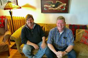 Chris Foster, left, and Patrick White in their Pine Hills apartment in Albany.