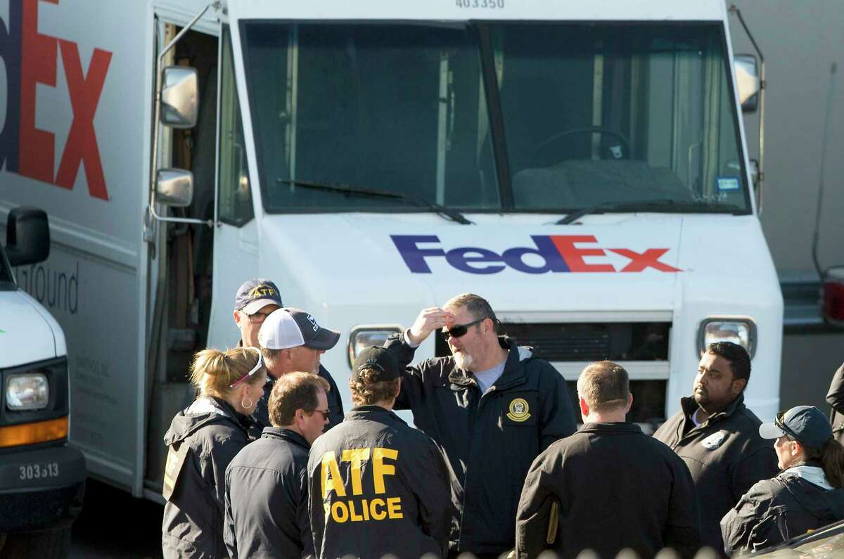 Federal officials investigate the scene Tuesday morning March 20, 2018 of a package bomb explosion at the FedEx ground shipping facility in Schertz. Officials have said the bomb appeared to be related to the four recent package explosions in Austin.