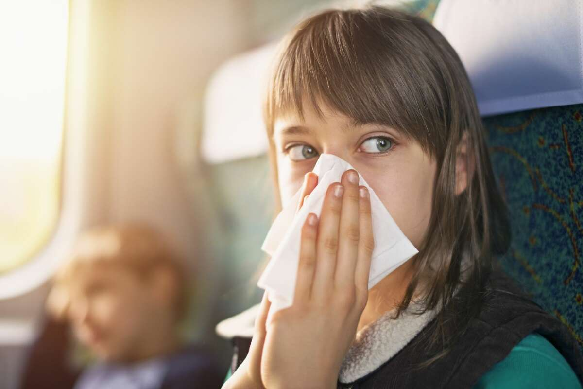 Whether or not you get sick on a plane or train has a lot to do with where you sit. And if your flight attendant is sick.