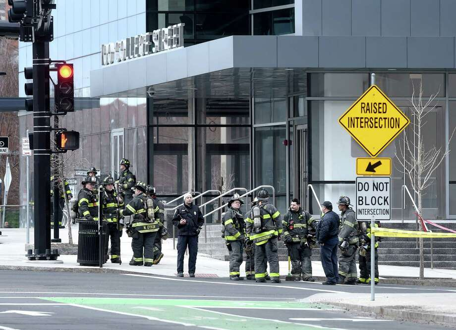 New Haven Fire Department personnel were on scene at 100 College Street in downtown New Haven responding to a report of a natural gas leak on March 20, 2018. Photo: Arnold Gold, Hearst Connecticut Media / New Haven Register