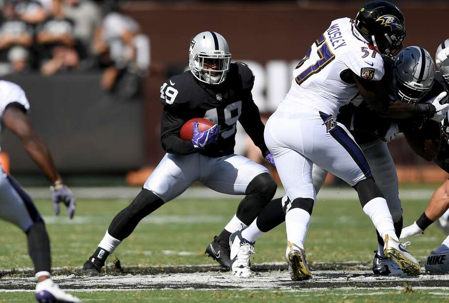 OAKLAND, CA - OCTOBER 08:  Jamize Olawale #49 of the Oakland Raiders carries the ball against the Baltimore Ravens during the second quarter of their NFL football game at Oakland-Alameda County Coliseum on October 8, 2017 in Oakland, California.  (Photo by Thearon W. Henderson/Getty Images) Photo: Thearon W. Henderson/Getty Images