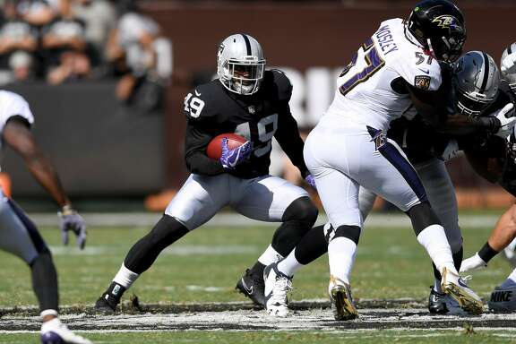 OAKLAND, CA - OCTOBER 08:  Jamize Olawale #49 of the Oakland Raiders carries the ball against the Baltimore Ravens during the second quarter of their NFL football game at Oakland-Alameda County Coliseum on October 8, 2017 in Oakland, California.  (Photo by Thearon W. Henderson/Getty Images)