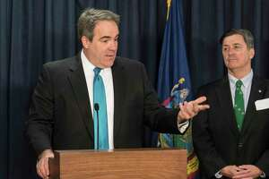 Ted Potrikus, president and CEO of the Retail Council of NYS, left, joins Albany County Comptroller Mike Conners in speaking at a press conference calling for internet taxes on sales to out of state firms even if they don't have a physical presence in New York State Tuesday March 19, 2018 at the Legislative Office Building in Albany, N.Y. (Skip Dickstein/Times Union)