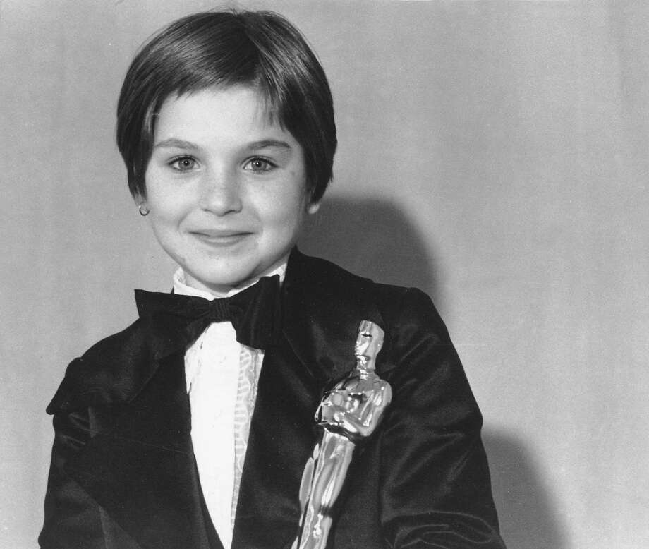 "** FILE ** Tatum O'Neal holds her Oscar statuette at the 46th Annual Academy Awards in Los Angeles, Caif., in this April 2, 1974 file photo. The 10-year-old won as Best Supporting Actress for her role in the movie ""Paper Moon."" (AP Photo, File) Photo: AP"