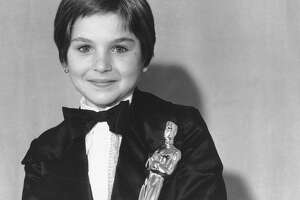 """** FILE ** Tatum O'Neal holds her Oscar statuette at the 46th Annual Academy Awards in Los Angeles, Caif., in this April 2, 1974 file photo. The 10-year-old won as Best Supporting Actress for her role in the movie """"Paper Moon."""" (AP Photo, File)"""