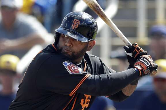 San Francisco Giants' Pablo Sandoval bats during a spring training baseball game against the Milwaukee Brewers, Wednesday, Feb. 28, 2018, in Maryvale, Ariz. (AP Photo/Carlos Osorio)