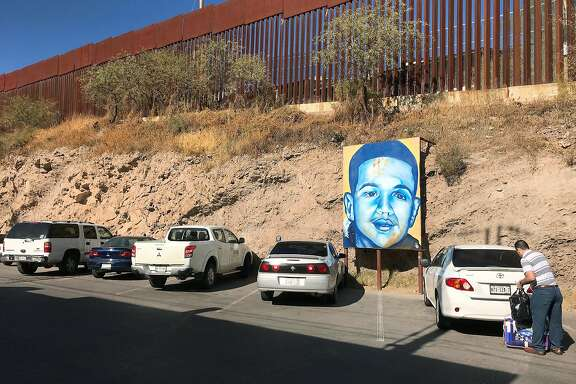 In this Dec. 4, 2017 photo, a portrait of 16-year-old Mexican youth Jose Antonio Elena Rodriguez, who was shot and killed in Nogales, Sonora, Mexico, is displayed on the street where he was killed that runs parallel with the U.S. border. A U.S. border patrol agent is going on trial for second-degree murder in U.S. District Court in Tucson on Tuesday, March 20, 2018, in a rare case Justice Department prosecution of a fatal cross-border Mexico shooting. Lonnie Swartz is charged with firing multiple shots from the Arizona side of the border into Nogales, Mexico more than five years ago and killing Rodriguez. (AP Photo/Anita Snow)