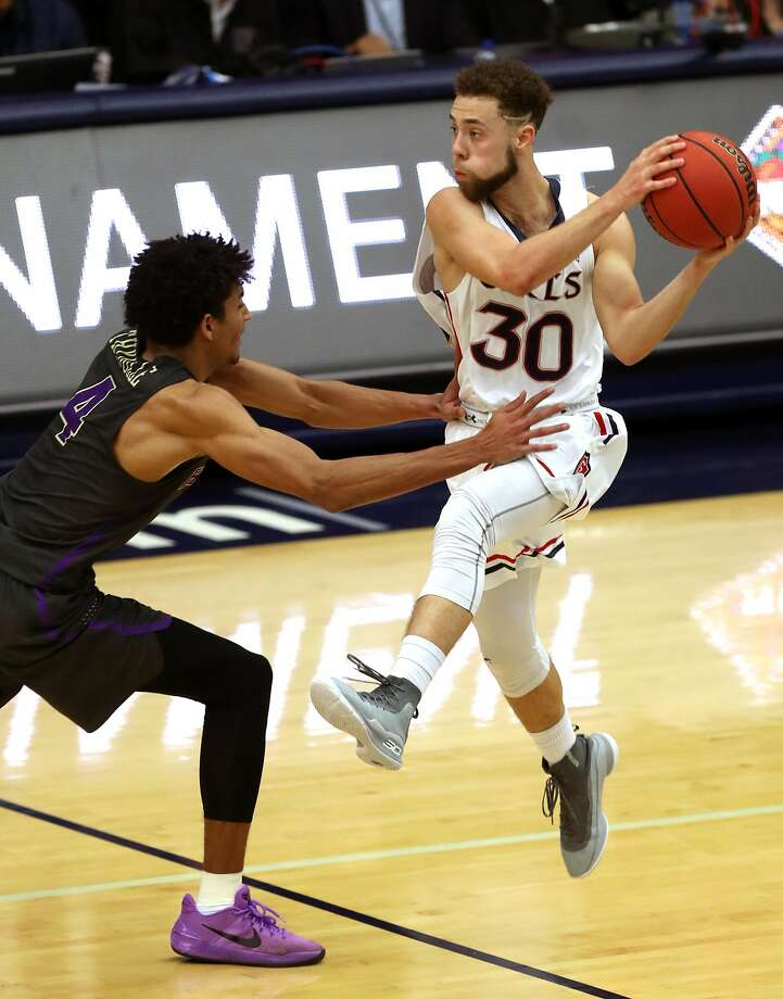 St. Mary's Jordan Ford is fouled by Washington's Matisse Thybulle in 4th quarter during the Gaels' 85-81 win in NIT 2nd round game in Moraga, Calif., on Monday, March 19, 2018. Photo: Scott Strazzante / The Chronicle