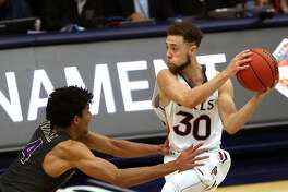 St. Mary's Jordan Ford is fouled by Washington's Matisse Thybulle in 4th quarter during the Gaels' 85-81 win in NIT 2nd round game in Moraga, Calif., on Monday, March 19, 2018.