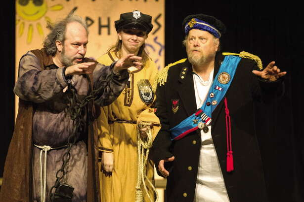 "Director Sean Thompson, left, and cast members Quint Bishop, right, and Kayla Adams perform in ""The Comedy of Errors"" by William Shakespeare during the first Conroe Shakespeare Festival."