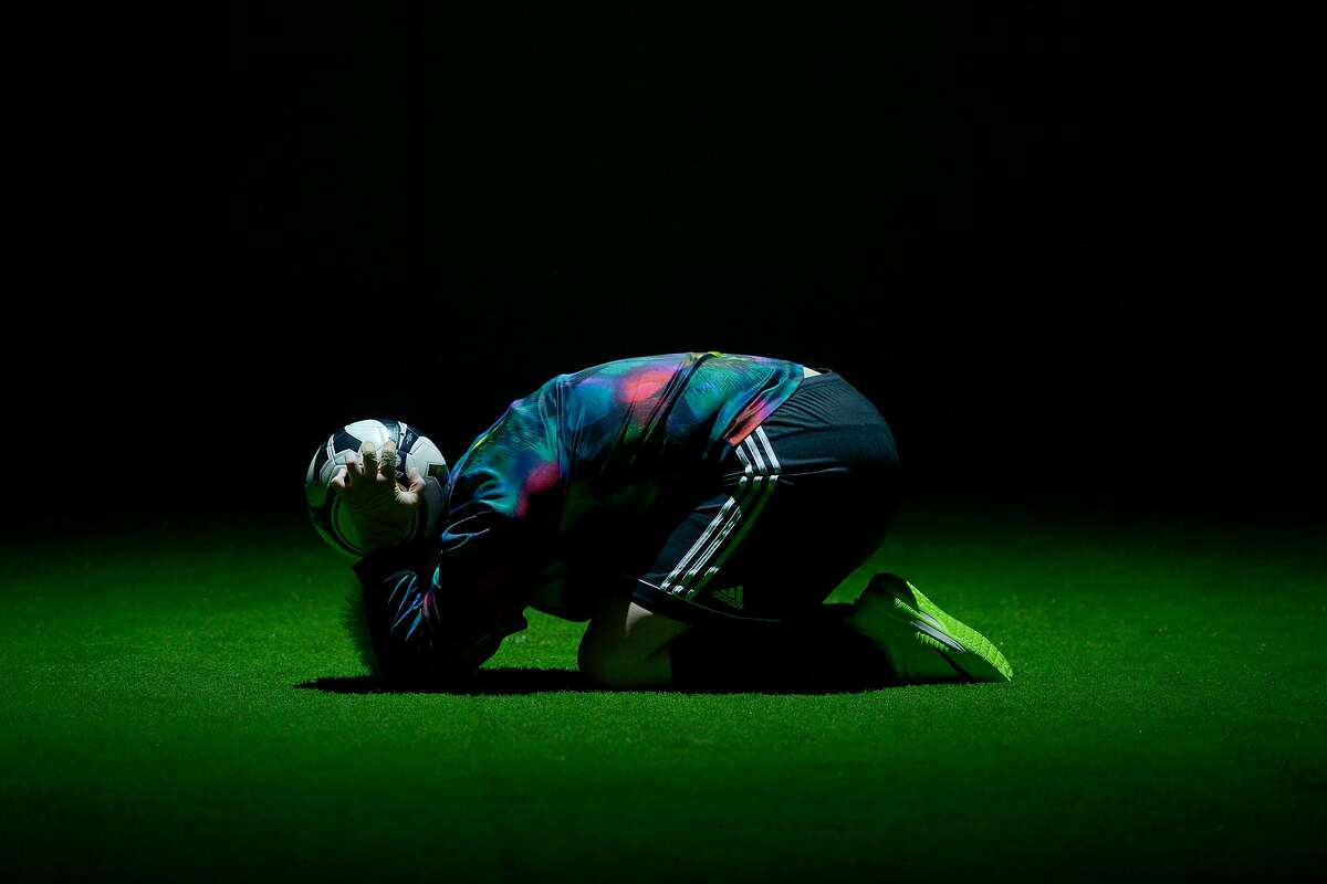 """Betsy Norton as #00 Goalie alone on the field in Marin Theatre Company's """"The Wolves."""""""