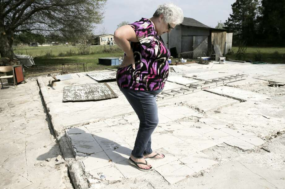 Diane Glover walks where the entrance was on her home before Hurricane Harvey struck in Crosby, Texas. Glover and her husband, Nolan, are living in a trailer on the property waiting for their new home. Photo: Elizabeth Conley/Houston Chronicle