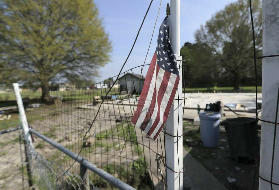 A small flag is propped on a temporary gate on Diane and Nolan Glover's property on Sunday, March 18, 2018, in Crosby, Texas. The couple, whose home is close to the Arkema plant, was destroyed by Hurricane Harvey. Photo: Elizabeth Conley/Houston Chronicle