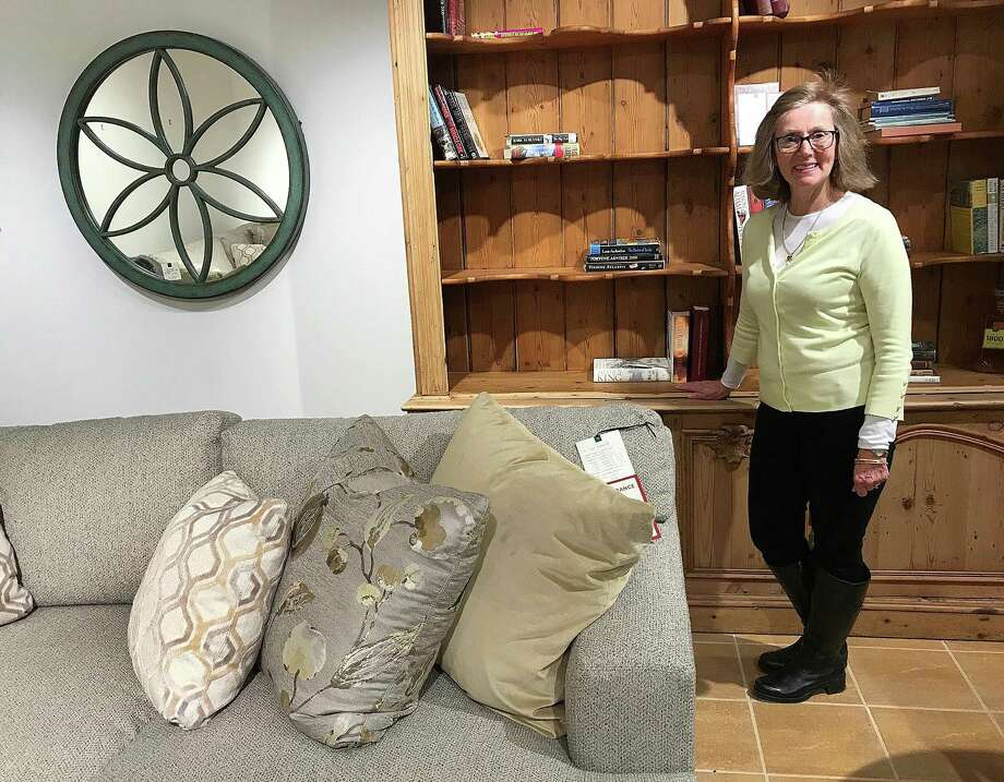 LJ Edwards Furniture and Design Studio employee Leslie Haber stands in one of the showcase rooms at the furniture store in Brookfield, Conn., on Tuesday, March 20, 2018. The store is closing on March 31. Photo: Chris Bosak / Hearst Connecticut Media / The News-Times