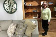 LJ Edwards Furniture and Design Studio employee Leslie Haber stands in one of the showcase rooms at the furniture store in Brookfield, Conn., on Tuesday, March 20, 2018. The store is closing on March 31.