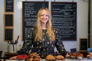 Baker Claire Ptak poses for a photgraph inside her bakery, Violet, in east London on March 20, 2018. Ptak has been asked to make the wedding cake for the forthcoming marriage of Britain's Prince Harry to his US fiancee, Meghan Markle.