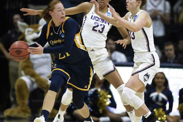 Quinnipiac's Jen Fay (21) looks to pass as UConn's Azurá Stevens (23) and Katie Lou Samuelson defend Quinnipiac's Jen Fay during a second-round NCAA Tournament game on Monday in Storrs.